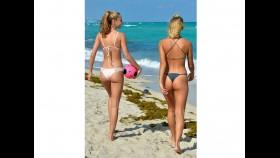 Bikini-clad models Selena Weber and Lauren-Ashley Maxey play soccer on the beach thumbnail