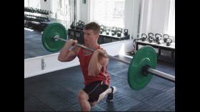Man does reverse lunge with barbell thumbnail