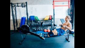 Fit man rowing on erg thumbnail
