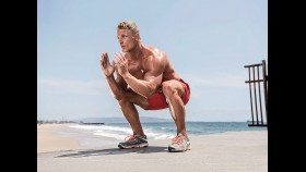 Man Does Squat During Sand Workout On The Beach thumbnail