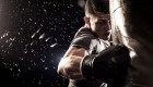 Man throwing a punch at boxing punching bag