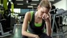Female-Frustrated-Fitness-Gripping-Bridge-Nose