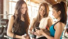 Group-Of-Girls-Looking-At-Phone-Gym