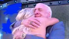 Ric Flair embracing daughter Charlotte