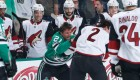 Antoine Roussel of the Dallas Stars gets physical against Luke Schenn of the Arizona Coyotes