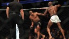 Daniel Cormier (L) Tries To Evade Jon Jones In The Light Heavyweight Title