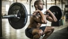 man performing barbell front squat exercise