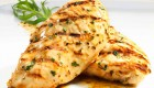 two chicken breasts in light herb sauce