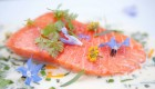 raw salmon with fresh herbs and flowers