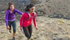 Women Running Up a Hill