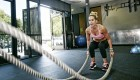 Woman Doing Battle Ropes at the Gym