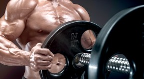 Muscular-Man-Putting-Additional-Plates-On-Barbell. thumbnail