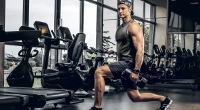 Young-Muscular-Man-Doing-Lunges-In-Dark-Gym miniatura